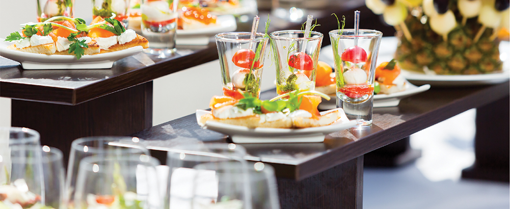 Image of a decorated restaurant buffet table with fruits
