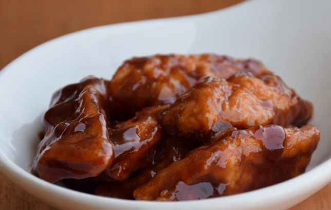 Photo of boneless chicken wings in BBQ sauce from Clay restaurant's appetizer menu