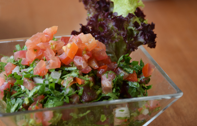 Image of traditional Lebanese salad called Tabouli from Clay's Lebanese Mezza menu