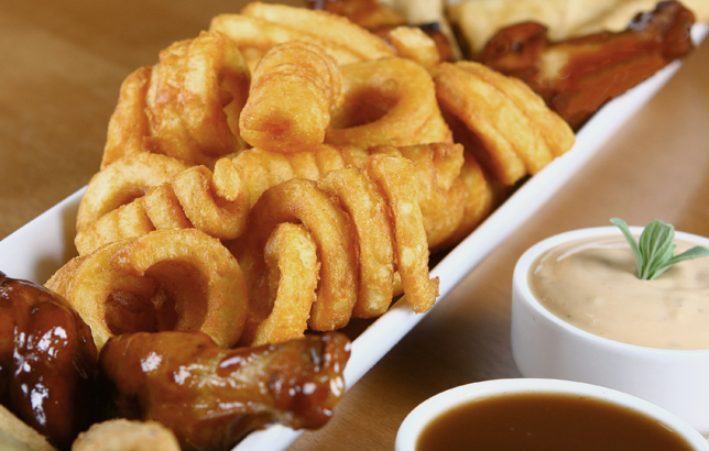 Image of curly fries, buffalo wings, garlic bread, and mozzarella sticks from Clay restaurant's appetizers menu