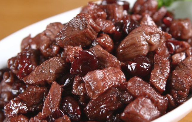 Photo of small meat cubes with dried cherry jam from Clay restaurant's Lebanese Mezza menu