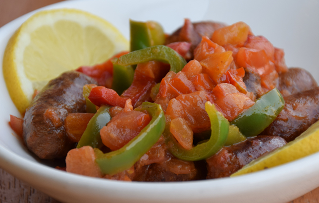 Image of Armenian sausages with tomatoes and green peppers from Clay restaurant's Lebanese Mezza menu