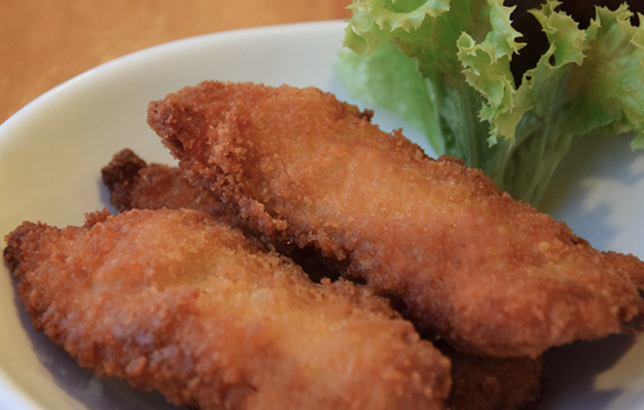 Image of four crispy chicken tenders on a plate